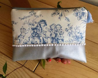 "Clutch in cotton and faux leather ""toile de Jouy and tassel""."