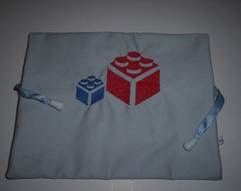Embroidered blocks in blue canvas bag