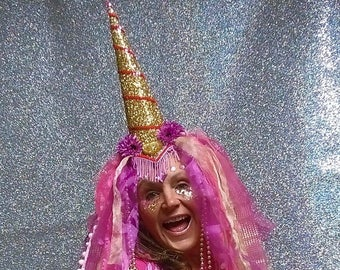 Glamourous showstopping glitter gold and pink unicorn horn headdress with organza wig.