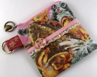 One of a kind vintage fabric coin purse or pouch. Vintage button adornment.