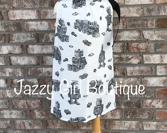 Robots, Trains, and Bolts Dress with Lg Black Ribbon that Ties Over One Shoulder Sizes 6 mos to 5 years.  Sizes 6, 7 or 8 Three Dollars More