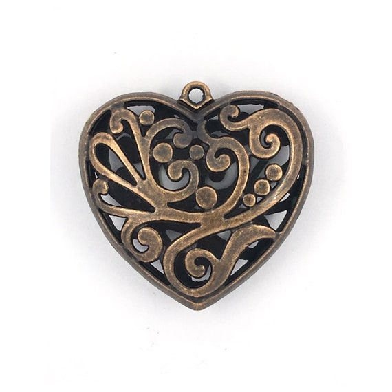 "Great charm - copper colored ""3D heart"""