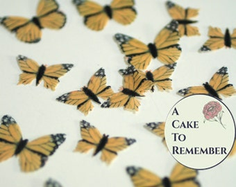 48 all orange monarchs small edible butterflies for a unique wedding cake topper. Wafer paper butterflies for cake decorating .