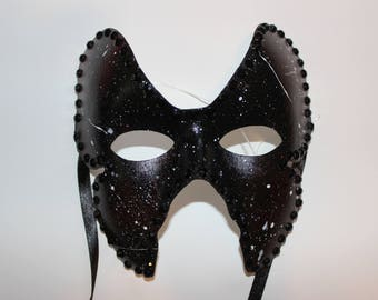 Black butterfly mask with diamonds and white paint splatter