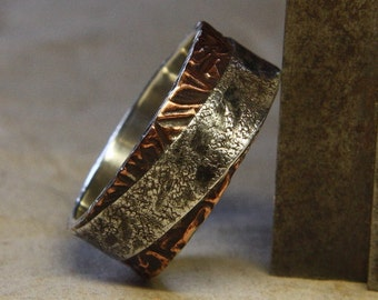 Two sides to every story. Mans ring of sterling silver and copper. Mans engagement ring.