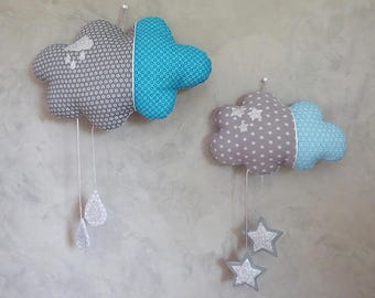 Set of 2 decorative cloud mobile is hung on the wall