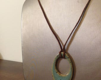 Handmade natural ceramic pendant in aqua