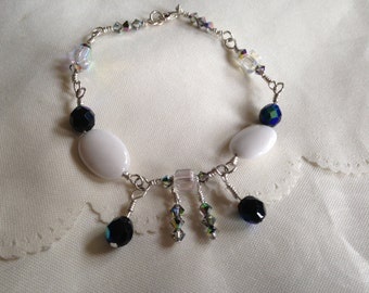 "Handmade ""Jay"" Bracelet. White Mountain Jade in sterling silver. Black swarovski crystal beads. Length is 8.5 inches."