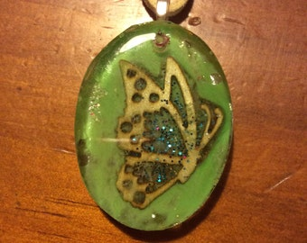 Lovely Green oval pendant with butterfly
