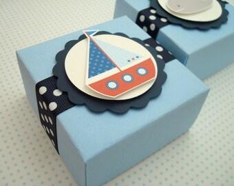 Boîtes de partie sur le thème nautique de Favor, bleu et rouge, la valeur de dix