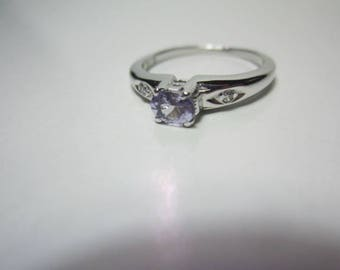 natural tanzanite 925 sterling silver ring. oval cut gemstone.