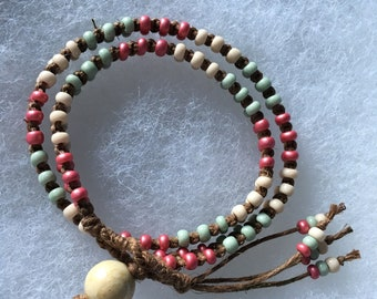Natural dark brown hemp and sage, ivory, and berry beads boho wrap bracelet