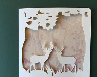 Cut greeting card - deer in forest