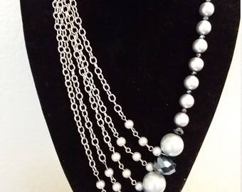 Asymmetrical chain, pearl and crystal necklace with matching earrings