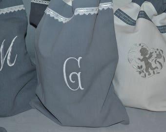 Old cloth laundry bag letter G