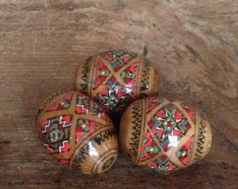 Trio of wooden eggs