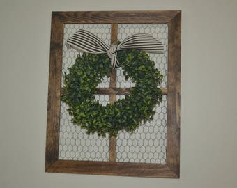 Boxwood wreath wall decoration