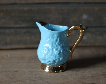 Blue and gold pitcher