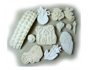ceramic stamps - clay stamps -texture stamps -soap stamp -pottery stamps -One time grab bag of  ( 12 )  bisque stamps -  ( 288 )