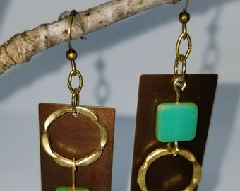 Mixed Metal, opposites attract. OOAK earrings with green czech beads.