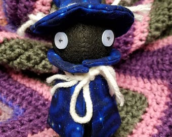 Wizard with Blue Cape and Moon Face Charm