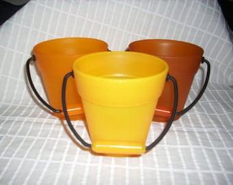 3 buckets, orange (566)