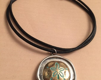 Sand Dollar medallion with a teal and gold textured pattern on a leather cord, summer jewelry, sand dollar charms