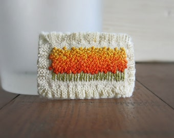 Floral Field Brooch - Hand Embroidered Flower Field Brooch in Shades of Orange and Yellow on Natural Linen