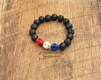 Skulls Red White Blue Lava Black Bracelet proceeds donated service dogs military veterans soldiers USA United States America rocker