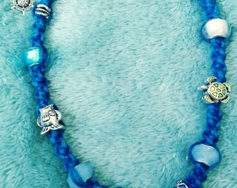 2 tone blue hemp necklace seahorse and turtle and fish beads