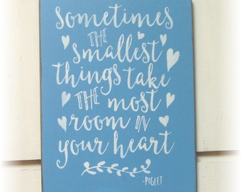 Sometimes the smallest things take up the most room in your heart wood sign