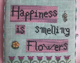 Happiness is smelling flowers