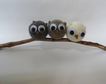 Three owls in felted wool.
