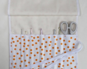 Handmade crochet hook case/roll. 100% cotton. White cotton with orange spots.