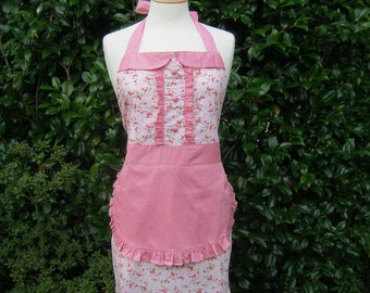 Retro apron with collar, tiny pink floral on a pink fabric, fully lined.
