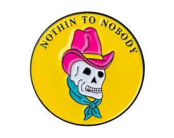 Nothin to nobody enamel pin. Western skull lapel pin.