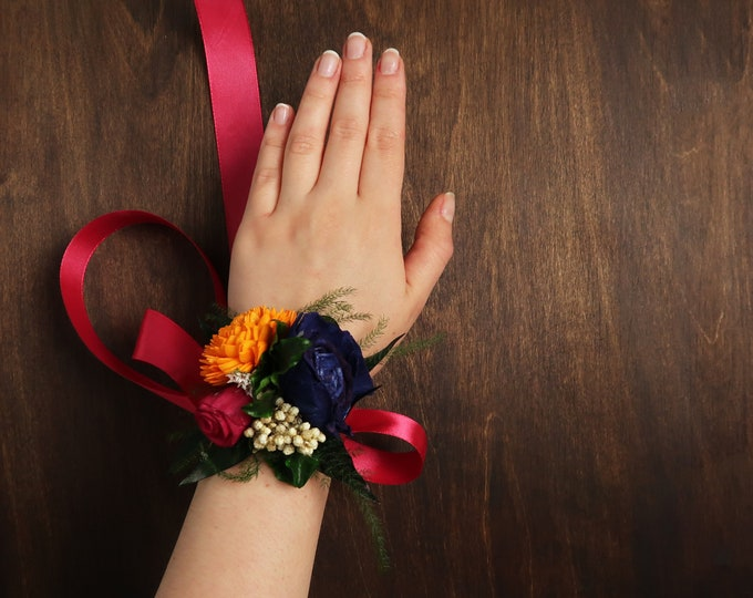 Colorful vibrant wild wedding wrist corsage yellow orange blue fuchsia pink sola flower boho bridesmaid mothers flowers preserved greenery