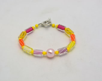 Cane Glass Bracelet with Pink Swarovski Pearl Accent. Springtime colors in fun Yellow & orange striped glass beaded bracelet. Unique. Fun.