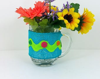 Burlap glass mug yellow and orange flowers with turquoise and lime green trim 122