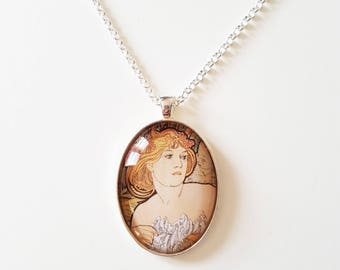Alfons Mucha 'The West End Review' detail, 30x40mm oval pendant in silver or antique bronze, includes complimentary chain