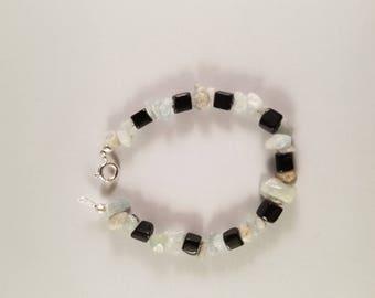 6 Inch black jade and blue gemstone chip bracelet.