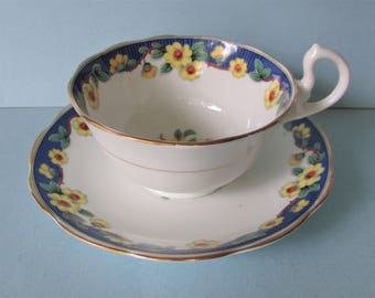 1930's Royal Albert Primrose Tea Cup, Saucer/ Blue band, vase, yellow primroses, Doris shape, footed tea cup, teacup, #6483