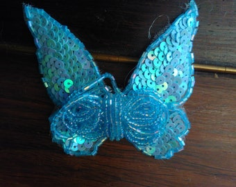 Sky blue colored beads and sequins Butterfly brooch