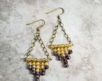 Yellow, and brown, chandillear earrings, with bronze