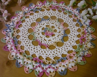 pastels and white doily