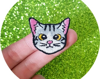 Cute Kitty Cat with Yellow Eyes Staring Something Iron On Embroidered Patch