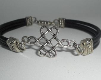 Black multi strand leather bracelet with silver metal Celtic knot