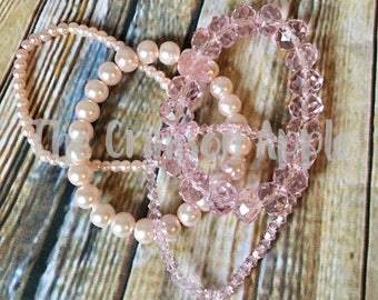 Set of 4 stretch bracelets, 2 pink pearl and 2 pink crystal