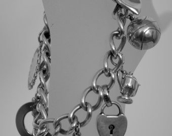 Antique Charm Bracelet Sterling 9 charms basketball marked 1924-1925