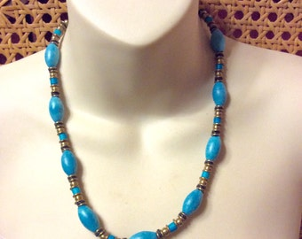 Vintage brass accents and turquoise ceramic beads tribal necklace.